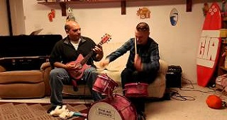 Watch Two Adult Men Rock Harder Than You On Pink Kid's Instruments
