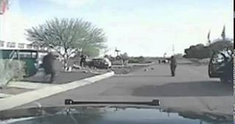 An Arizona Police Officer Driving His Car