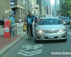 Toronto Taxi Driver Side Hits Annoying Delivery Cyclist