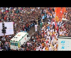 Ambulance In India Has No Problem Carving Through A Large Crowd