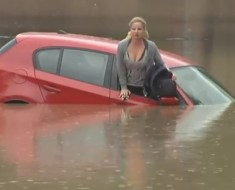 Woman Rescues Herself From The Flood To The Roof Of Her Car