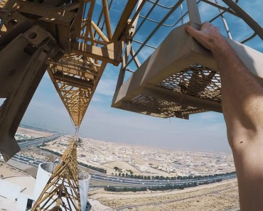 Daredevils Walks Over Extended Cranes From One Building To Another